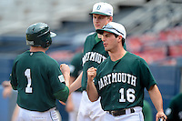 Dartmouth Big Green outfielder Ryan Toimil (16) greets Nick Ruppert (1) to the dugout after a play during a game against the Long Island Blackbirds at Chain of Lakes Stadium on March 17, 2013 in Winter Haven, Florida.  Dartmouth defeated UAB 11-4.  (Mike Janes/Four Seam Images)