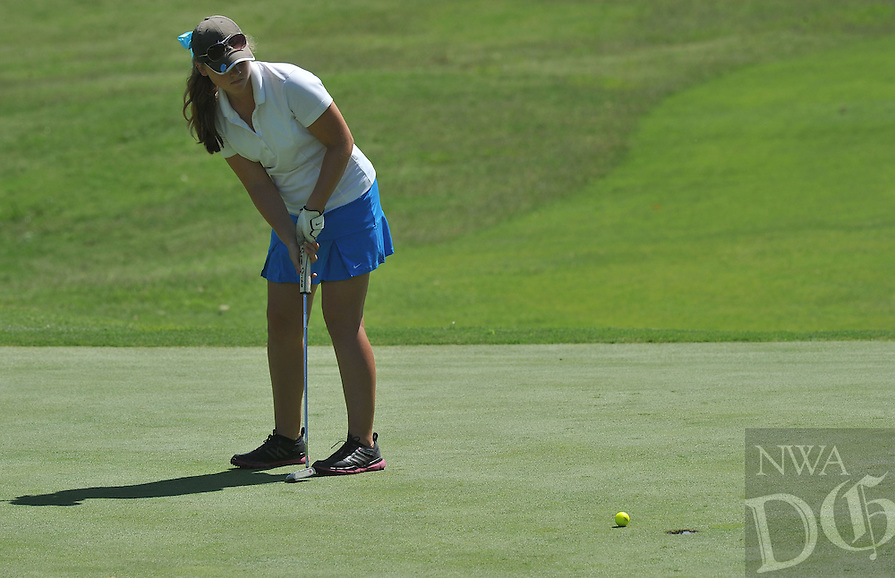 NWA Media/Michael Woods --06/24/2014-- w @NWAMICHAELW...Josie Roberson from Maumelle, watches her putt on the 12th green Tuesday morning during the last round of the ASGA Stroke Play tournament at Shadow Valley Country Club in Rogers.