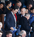 Craig Mather takes his seat in the directors box