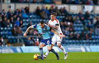 Max Muller of Wycombe Wanderers holds off Jimmy Smith of Crawley Town during the Sky Bet League 2 match between Wycombe Wanderers and Crawley Town at Adams Park, High Wycombe, England on 25 February 2017. Photo by Andy Rowland / PRiME Media Images.
