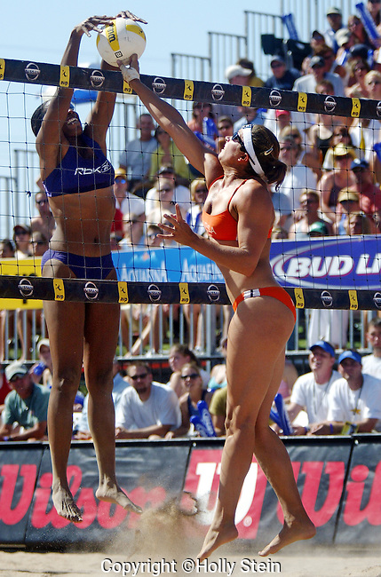 Misty May-Treanor (R) and Annett Davis joust at the net during the AVP Tempe Open.