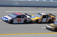 Apr 24, 2009; Talladega, AL, USA; NASCAR Sprint Cup Series driver Dale Earnhardt Jr (88) is bump drafted by Kyle Busch (18) during practice for the Aarons 499 at Talladega Superspeedway. Mandatory Credit: Mark J. Rebilas-