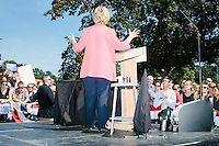 Democratic presidential candidate and former First Lady and Secretary of State Hillary Rodham Clinton speaks to a crowd at a rally in Portsmouth, New Hampshire. At the rally, New Hampshire senator Jeanne Shaheen endorsed Clinton.