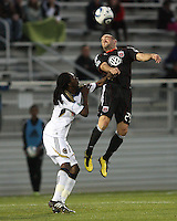 Branden Barklage(24) of D.C. United heads away from Keon Daniel(17) of the Philadelphia Union during a play-in game for the US Open Cup tournament at Maryland Sportsplex, in Boyds, Maryland on April 6 2011. D.C. United won 3-2 after overtime penalty kicks.
