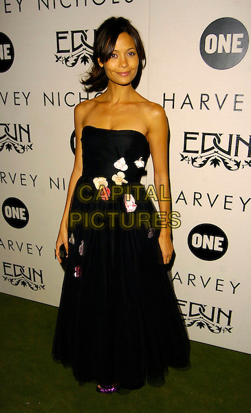 "THANDIE NEWTON.""Edun One"" launch party, Harvey Nichols, London, UK..October 18th, 2006.Ref: CAN.full length black sheer dress strapless floral embroidery.www.capitalpictures.com.sales@capitalpictures.com.©Can Nguyen/Capital Pictures"