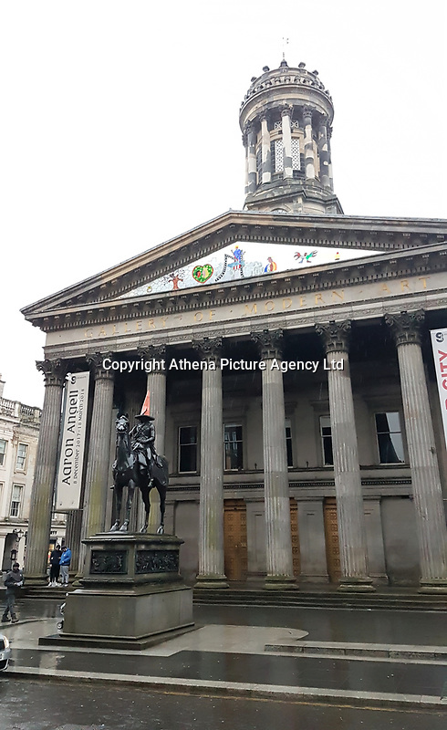 Pictured: The equestrian Wellington Statue of Arthur Wellesley, 1st Duke of Wellington, outside the Gallery of Modern Art at the Royal Exchange Square in Glasgow.<br /> Re: Glasgow, Scotland, UK. 07 April 2018