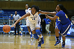 30 October 2014: Duke's Azura Stevens (11) steals the ball from Limestone's Morgan Brown (right). The Duke University Blue Devils hosted the Limestone College Saints at Cameron Indoor Stadium in Durham, North Carolina in an NCAA Women's Basketball exhibition game. Duke won the game 100-33.