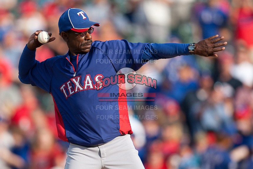 """Texas Rangers manager Ron Washington #38 throws out the ceremonial first pitch before the MLB exhibition baseball game against the """"AAA"""" Round Rock Express on April 2, 2012 at the Dell Diamond in Round Rock, Texas. The Rangers out-slugged the Express 10-8. (Andrew Woolley / Four Seam Images)."""