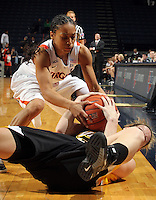Dec. 18, 2010; Charlottesville, VA, USA; Virginia Cavaliers guard China Crosby (1) fights for the ball with UMBC Retrievers guard Michele Brokans (21) during the game at the John Paul Jones Arena. Virginia won 61-46. Mandatory Credit: Andrew Shurtleff