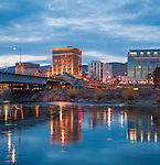 Missoula Montana downtown area viewed from across the Clark Fork River. Lights of the downtown area at dusk. The Wilma building. First Interstate Bank building.