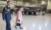 03/02/2020 - Queen Elizabeth II with Station commander Group captain James Beck watches air crew at work on a training model F-35B Lightning II fighter at RAF Marham where she inspected the new integrated training centre that trains personnel on the maintenance of the new RAF F-35B Lightning II strike aircraft. Marham, Norfolk. Photo Credit: ALPR/AdMedia