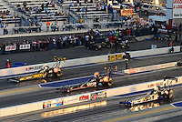 Apr. 13, 2012; Concord, NC, USA: NHRA top fuel dragster drivers (right to left) Pat Dakin , Steve Torrence and Morgan Lucas race four-wide during qualifying for the Four Wide Nationals at zMax Dragway. Mandatory Credit: Mark J. Rebilas-
