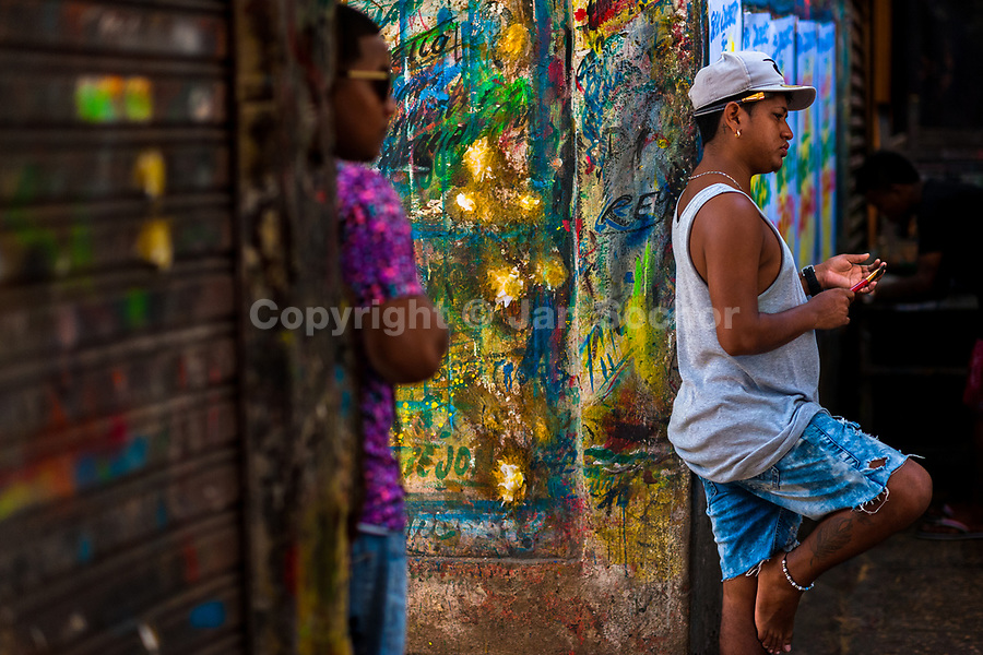 "Colombian sign painters hang out in the sign painting workshop in Cartagena, Colombia, 11 December 2017. Hidden in the dark, narrow alleys of Bazurto market, a group of dozen young men gathered around José Corredor (""Runner""), the master painter, produce every day hundreds of hand-painted posters. Although the vast majority of the production is designed for a cheap visual promotion of popular Champeta music parties, held every weekend around the city, Runner and his apprentices also create other graphic design artworks, based on brush lettering technique. Using simple brushes and bright paints, the artisanal workshop keeps the traditional sign painting art alive."