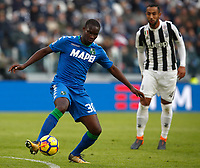 Calcio, Serie A: Juventus - Sassuolo, Torino, Allianz Stadium, 4 Febbraio 2018. <br /> Sassuolo's Khouma Babacar (l) in action with Juventu's Medhi Benatia (r) during the Italian Serie A football match between Juventus and Sassuolo at Torino's Allianz stadium, February 4, 2018.<br /> UPDATE IMAGES PRESS/Isabella Bonotto