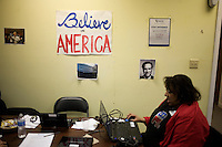 Volunteers in a phone bank call people to gather support for Mitt Romney at the Romney New Hampshire campaign headquarters in Manchester, New Hampshire, on Jan. 7, 2012. Romney is seeking the 2012 Republican presidential nomination.