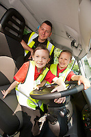 Six year olds Savanna Tate (left) and Savanah Ibbeson together with driver Jamie Wigfield and the ASDA delivery van they named