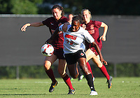 WINSTON-SALEM, NORTH CAROLINA - August 30, 2013:<br /> Christine Exeter (22) of Louisville University battles her way past Jordan Coburn (19) of Virginia Tech during a match at the Wake Forest Invitational tournament at Wake Forest University on August 30. The game ended in a 1-1 tie.