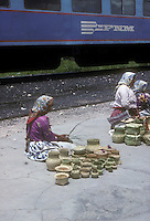 Tarahumara women selling pine needle baskets beside the Ferrocarriles Nacional de Mexico train, Copper Canyon, Chihuahua, Mexico. This is an archival image taken in 1990.