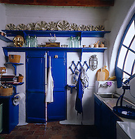 This simple kitchen has a cheerful Mediterranean blue and white colour scheme