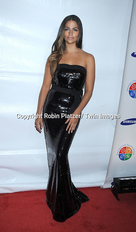 Camila Alves in Dolce and Gabanna dress posing for photographers at The 9th Annual Samsung Four Seasons of Hope Gala on June 15, 2010 at Cipriani Wall Street in New York City.