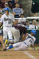 UCLA outfielder Brian Carroll (24) is tagged out by Mississippi State Bulldogs catcher Mitch Slaughter (29)during the 2013 Men's College World Series Final on June 25, 2013 at TD Ameritrade Park in Omaha, Nebraska. The Bruins defeated the Bulldogs 8-0, winning the National Championship. (Andrew Woolley/Four Seam Images)