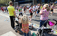 17 APR 2011 - LONDON, GBR - A family watches the runners passing during the London Marathon (PHOTO (C) NIGEL FARROW)
