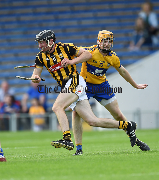 Conor Delaney of Kilkenny in action against Oisin Donnellan of Clare during their Intermediate All-Ireland final at Thurles. Photograph by John Kelly.