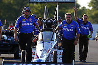 Aug 15, 2014; Brainerd, MN, USA; Crew members with  NHRA top fuel dragster driver Morgan Lucas wait their turn to push up into the water box during qualifying for the Lucas Oil Nationals at Brainerd International Raceway. Mandatory Credit: Mark J. Rebilas-