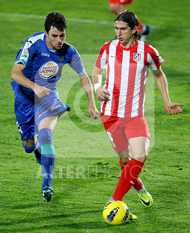 Getafe's Michel (l) and Atletico de Madrid's Filipe Luis during La Liga match.November 6,2011. (ALTERPHOTOS/Acero)