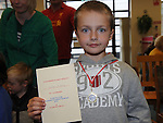 Matthew O'Reilly pictured with his medal and certificate from the Going For Gold Reading at the library. Photo: Colin Bell/pressphotos.ie