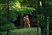 two fireman surveying the scene of a burned house in Rawdon, Quebec