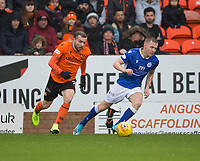 16th November 2019; Tannadice Park, Dundee, Scotland; Scottish Championship Football, Dundee United versus Queen of the South; Paul McMullan of Dundee United goes past Dan Pybus of Queen of the South  - Editorial Use