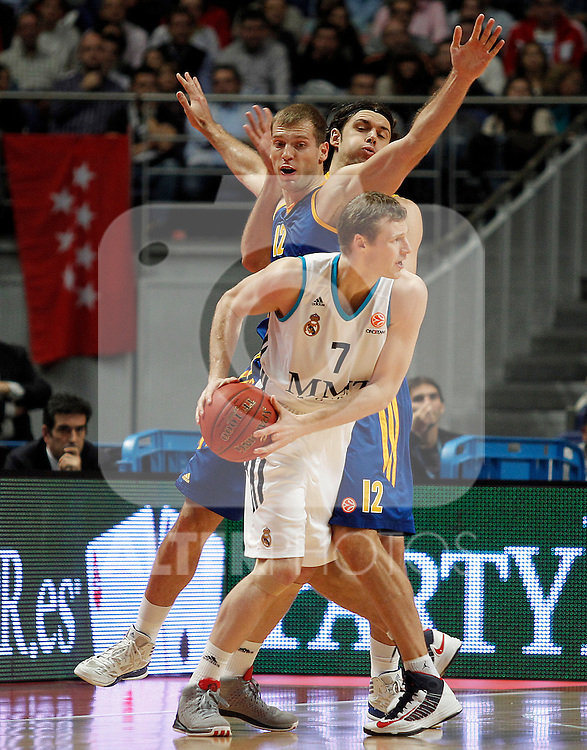 Real Madrid's Martynas Pocius (f) and BC Khimki MR's Sergey Monya (c) and Kresimir Loncar (b) during Euroleague 2012/2013 match.November 23,2012. (ALTERPHOTOS/Acero)