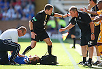 Ally McCoist checks on David Weir after the Rangers captain took a knock