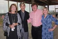 NWA Democrat-Gazette/CARIN SCHOPPMEYER Karen Suen (from left), Dr. James Suen, Terry Suen and Cathy Suen attend the Friends of UAMS gathering Tuesday evening.