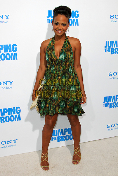 "CHRISTINA MILIAN.""Jumping The Broom"" Los Angeles Premiere Held At The Arclight Cinerama Dome Theatre, Hollywood, California, USA..May 4th, 2011.full length green print halterneck dress silver clutch bag .CAP/ADM/KB.©Kevan Brooks/AdMedia/Capital Pictures."