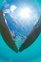Looking up through clear water at two kayaks.St. John, US Virgin Islands