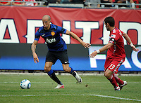 Manchester United midfielder Gabriel Obertan (26) dribbles into position for a shot while Chicago Fire defender Gonzalo Segares (13) defends.  Manchester United defeated the Chicago Fire 3-1 at Soldier Field in Chicago, IL on July 23, 2011.