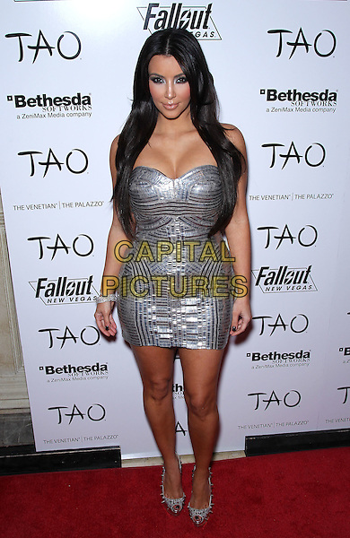 "KIM KARDASHIAN.Kim Kardashian celebrates her 30th birthday with ""Fallout: New Vegas"" at Tao Nightclub inside the Venetian Resort Hotel and Casino, Las Vegas, Nevada, USA, 15th October 2010..full length strapless cleavage silver mini dress shiny patterned studded peep toe shoes studs christian louboutin platform .CAP/ADM/MJT.© MJT/AdMedia/Capital Pictures."