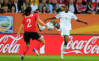 Emily Zurrer (l) of team Canada and Perpetua Nkwocha of team Nigeria during the FIFA Women's World Cup at the FIFA Stadium in Dresden, Germany on July 5th, 2011.