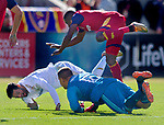 Los Angeles FC forward Carlos Vela (10) falls over Real Salt Lake goalkeeper Nick Rimando (18) as Real Salt Lake defender Demar Phillips (17) leaps over them as Vela scores a goal in the second half Saturday, March 10, 2018, during the Major League Soccer game at Rio Tiinto Stadium in Sandy, Utah. LAFC beat RSL 5-1. (© 2018 Douglas C. Pizac)