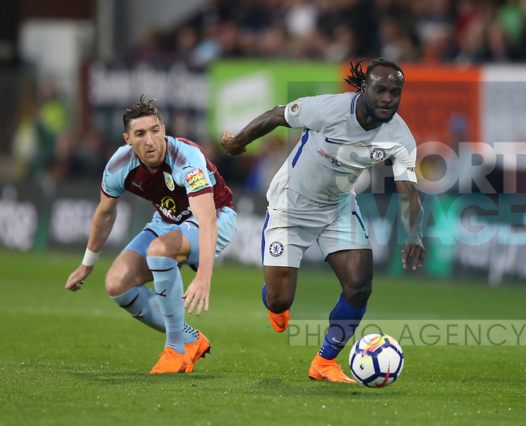 Victor Moses of Chelsea gets away from Jeff Hendrick of Burnley during the premier league match at the Turf Moor Stadium, Burnley. Picture date 19th April 2018. Picture credit should read: Simon Bellis/Sportimage