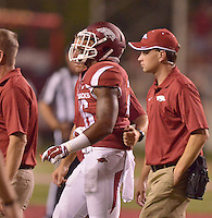 STAFF PHOTO BEN GOFF  @NWABenGoff -- 09/20/14 <br /> Trainers help Arkansas safety Rohan Gaines off the field during the fourth quarter of the game against Northern Illinois in Reynolds Razorback Stadium in Fayetteville on Saturday September 20, 2014.