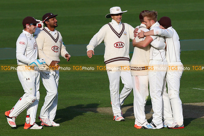 Matthew Dunn of Surrey (2nd R) is congratulated on taking the wicket of Nick Browne - Surrey CCC vs Essex CCC - LV County Championship Division Two Cricket at the Kia Oval, Kennington, London - 27/04/15 - MANDATORY CREDIT: Gavin Ellis/TGSPHOTO - Self billing applies where appropriate - contact@tgsphoto.co.uk - NO UNPAID USE