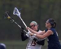 Boston College defender Jessie Coffield (15) stymied by University of New Hampshire midfielder Kate Keagins (6). Boston College defeated University of New Hampshire, 11-6, at Newton Campus Field, May 1, 2012.