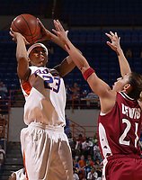 Florida's Tamia Williams (23) shoots over Arkansas' India Lewis (21) Thursday, Feb. 21, 2002, in Gainesville, Fla. (AP Photo/ Dede Smith)