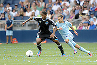 San Jose midfielder Khari Stephenson (7) pursued by Graham Zusi... Sporting Kansas City defeated San Jose Earthquakes 2-1 at LIVESTRONG Sporting Park, Kansas City, Kansas.