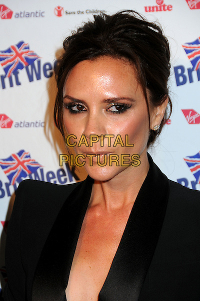 "VICTORIA BECKHAM .BritWeek 2010 Charity Event: ""Save The Children and Virgin Unite"" held at the Beverly Wilshire Hotel, Beverly Hills, California, USA, 22nd April 2010..portrait headshot black hair up make-up earrings diamond studs jacket  funny face mouth .CAP/ADM/BP.©Byron Purvis/AdMedia/Capital Pictures."
