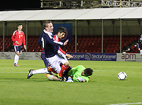 Hakob Loretsyan makes a crucial tackle on John Herron as Gregor Harutyunyan misses in the Scotland v Armenia UEFA European Under-19 Championship Qualifying Round match at New Douglas Park, Hamilton on 9.10.12.