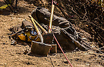 September 13, 2004 Buck Meadows --Tuolumne Fire –- Tools left behind by Columbia CDF Helitack Crew 404 near Lumsden Bridge on the Tuolumne River, Stanislaus National Forest. The Tuolumne Fire was a small very fast-moving fire that started around noon on September 12, 2004 near Lumsden Bridge at the bottom of the Tuolumne River.  The fire moved rapidly up the 80-plus-degree slope catching Cal Fire Helitack firefighters, tragically killing firefighter Eva Marie Schicke and injuring five others.